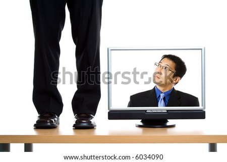 A business concept of a businessman trapped inside a monitor - stock photo