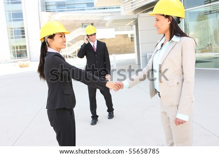 A  business construction man and woman team handshake at work site