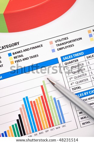 A business financial chart with a pen pointing at a bar graph. There are lots of colors and money symbols. Use it for accounting, statistics or earnings data.