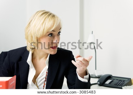 A business girl pointing at somebody