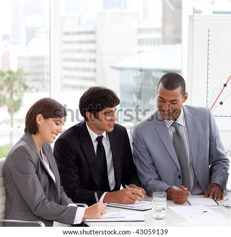 A Business group showing diversity discussing a new strategy in a meeting - stock photo