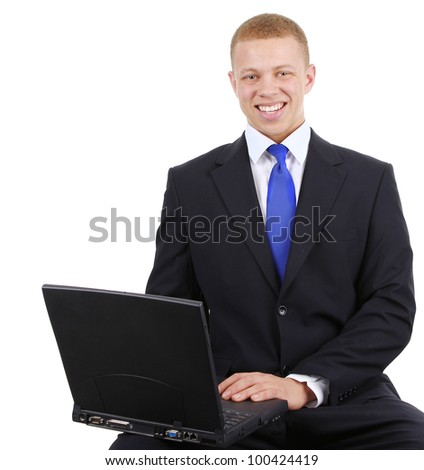 a business guy sitting down using a laptop, isolated on white - stock photo