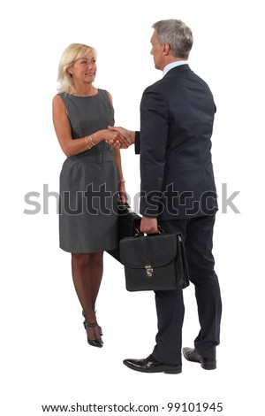 A business handshake - stock photo