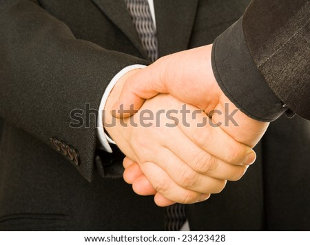 A business handshake. Isolated on white background - stock photo