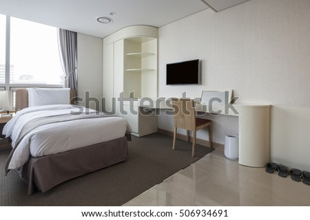 A business hotel room with tv(television, lcd, led, 4k, 8k), curtain, table, chair, window in seoul, korea.