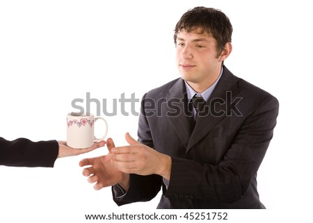 A business man accepting a cup of something from a woman. - stock photo
