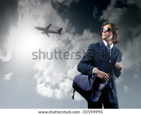 a business man and a airplane - stock photo