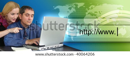 A business man and woman are sitting at a  desk and looking at a laptop computer with an abstract internet search projecting out of it. Use it for a technology header.