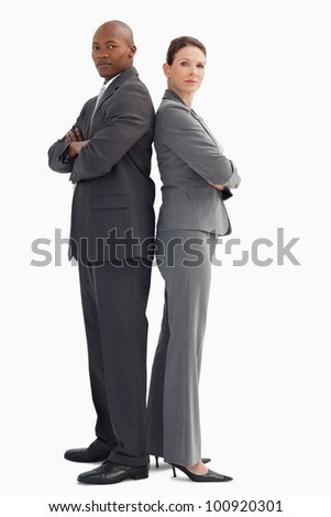 A business man and woman are standing with back to back - stock photo