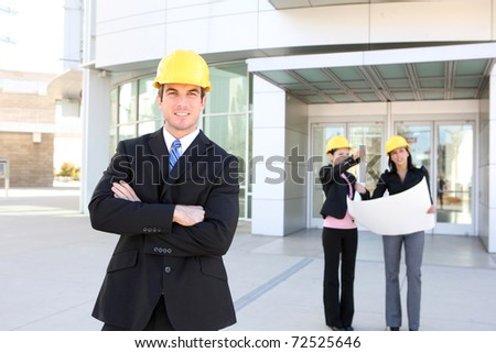 A business man and woman construction team at office building
