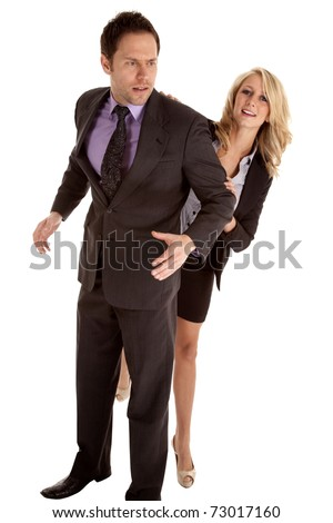 A business man and woman fighting and trying to get around the man. - stock photo