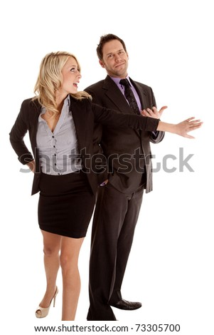 A business man and woman fighting to get their first. - stock photo