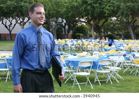 A business man attending a banquet outside - stock photo