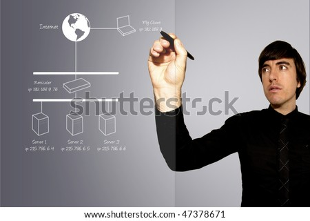 A business man draws a network topology diagram on a sheet of glass - stock photo