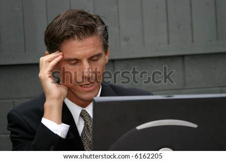 a business man expresses various emotions while working with his lap top computer, from frustration, to surprise, to confusion, to joy, happyness, tiredness and headaches in this series of concepts - stock photo