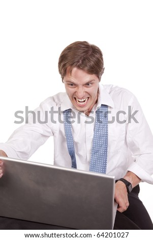 A business man getting ready to throw his computer because of his anger.