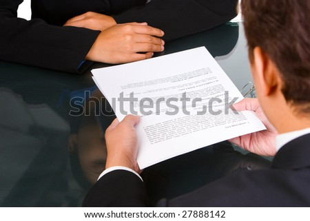 A business man give an agreement document to customer. - stock photo