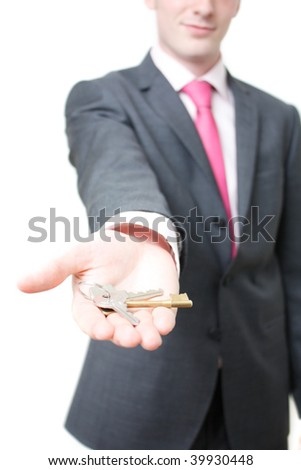 A business man giving you the keys to a home - stock photo
