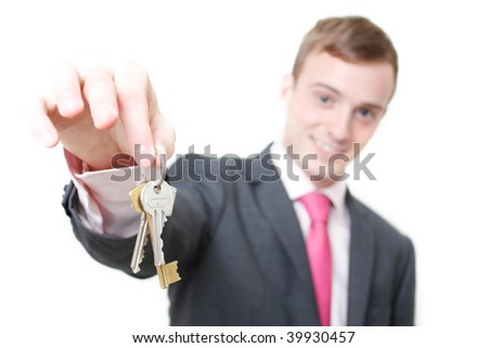 A business man giving you the keys to a home