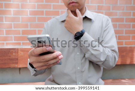 A business man hand hold(touch) a Smart Phone on his hand