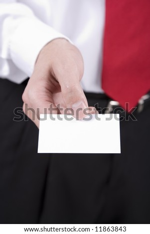 A Business Man handing a business card to someone - stock photo