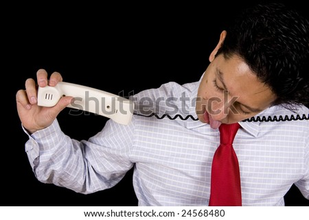 A business man hanged with the cable phone isolated on black