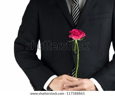 A business man having a pink rose isolated on white background