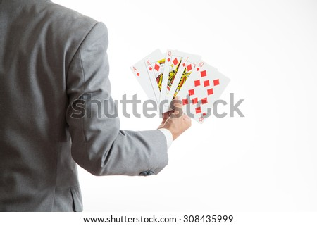 A business man holding a card - stock photo