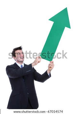 A business man holding a green arrow up indicating success - stock photo