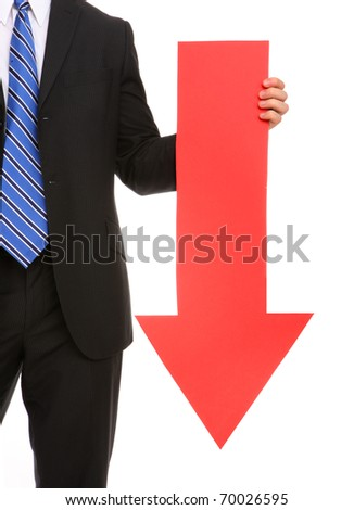 A business man holding a red arrow down indicating failure - stock photo