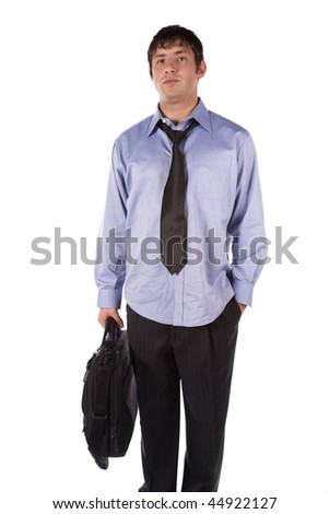 A business man holding his bag with his tie loosened with a serious expression on his face.