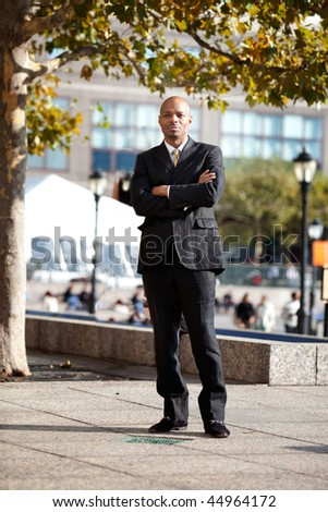 A business man in a city setting outside - stock photo