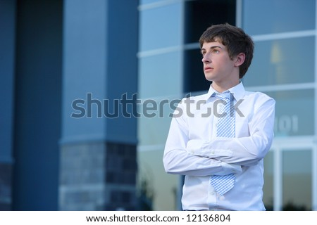 A business man in front of an office building
