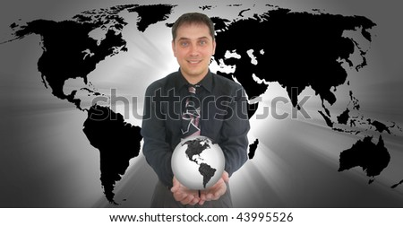 A business man is holding a globe of the Earth in his hands. There is a black and white color scheme. - stock photo