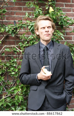 A Business man is looking relax, whilst he thinks over some ideas. - stock photo