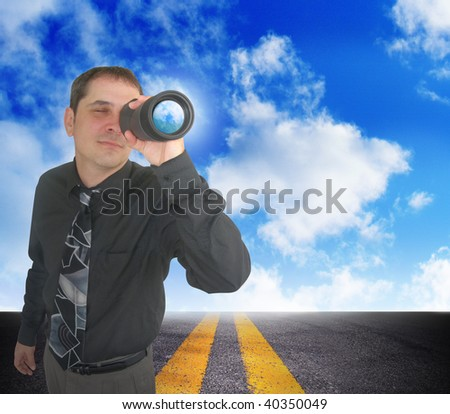 A business man is looking through binoculars. There are clouds behind him and a road. Can represent the future and planning ahead or a strategy and a discovery of an idea. - stock photo