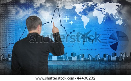A business man is pointing at financial figures. There are line graphs and pie charts with data. There are also travel themes like a map and airplane. - stock photo