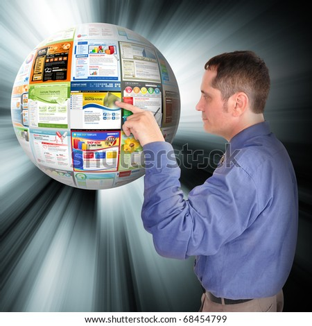 A business man is pointing to an abstract internet ball with websites on it. There are glowing rays coming out of it. Use it for a technology concept. - stock photo