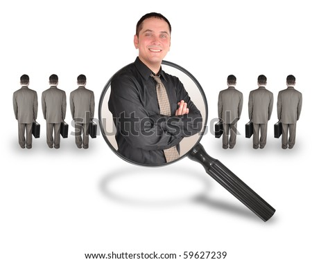 A business man is smiling inside of a magnifying glass. There are other business men turned and standing. Use it for a job search, employee candidate promotion or advantage concept.
