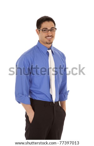A business man is standing with a smile on his face. - stock photo