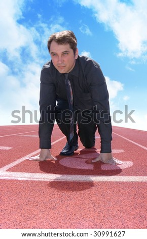 A business man is starting a race / competition on a red track. This photo can represent a variety of ideas from competition to leadership. - stock photo