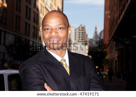 A business man isolated against a street background