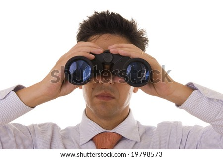 A business man looking through binocular