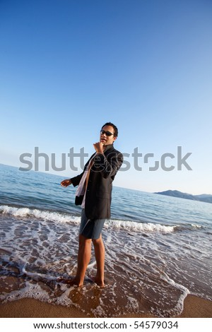 A business man on a holiday at the beach - stock photo
