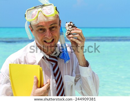 A business man on holiday dressed in business attire, holding his flippers, eating a snorkel and using a cowrie shell as a mobile phone.