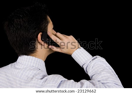 A business man on phone isolated on black - stock photo