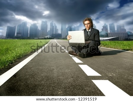 a business man on the street with a laptop - stock photo