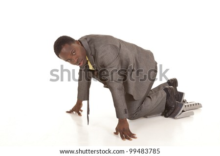 A business man ready for the race in the business world, in his suit on blocks. - stock photo