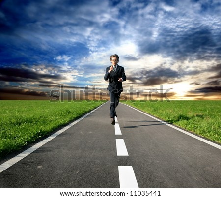 a business man run on the street - stock photo