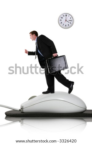 A business man running on a computer mouse - stock photo